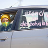 """Nicole Bauman, of Elkhart, decorates her vehicle supporting """"Indiana Joins Nationwide Car Caravans Demanding Dignity For Immigrant Workers"""" Friday afternoon in the parking lot of 2401 Middlebury Street, Elkhart."""