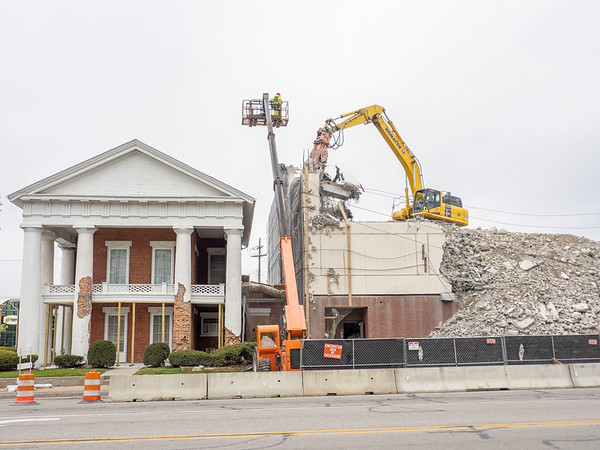 Mackenzie Companies equipment operator knocks down a portion of the South wall of the Elkhart County Jail Tuesday morning.