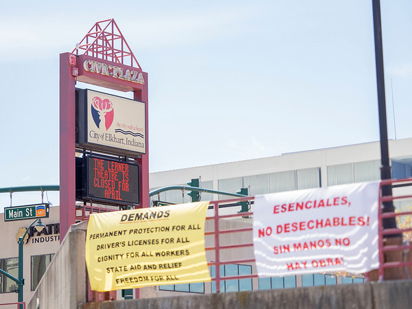 """Demands of the INmigrantes hang on the railing during the """"Indiana Joins Nationwide Car Caravans Demanding Dignity For Immigrant Workers"""" Friday afternoon in the parking lot of the Civic Plaza in Elkhart."""