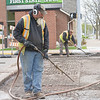 Niblock  Contractors uncover brick road at the intersection of North Main Street and West Clinton Street  Tuesday morning.