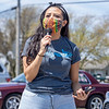 """INmigrantes MC """"Bella"""" speaks during the """"Indiana Joins Nationwide Car Caravans Demanding Dignity For Immigrant Workers"""" Friday afternoon in the parking lot of 2401 Middlebury Street, Elkhart."""