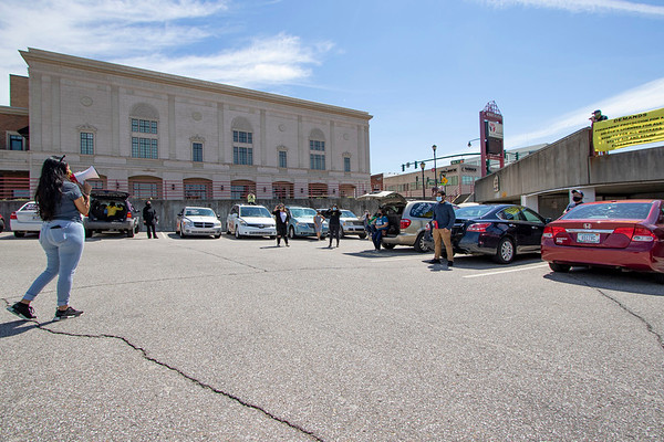 """INmigrantes MC """"Bella"""" speaks during the """"Indiana Joins Nationwide Car Caravans Demanding Dignity For Immigrant Workers"""" Friday afternoon in the parking lot of the Civic Plaza in Elkhart."""