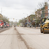Steamroller operator makes a pass down North Main Street near the intersection of North Main Street and West Lincoln Avenue Tuesday afternoon.
