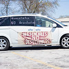 """May Day Rally participants decorate their vehicle supporting """"Indiana Joins Nationwide Car Caravans Demanding Dignity For Immigrant Workers"""" Friday afternoon in the parking lot of 2401 Middlebury Street, Elkhart."""