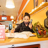 Maple Indian Cuisine Manager Rosie Sing takes an order from a customer over the phone Tuesday morning at Maple Indian Cuisinein Goshen.