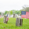 American flags blow in the wind at a veteran memorial decorated for Memorial Day Tuesday morning at Oakridge Cemetery.
