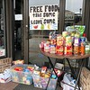 Amy Lant-Wenger | The Goshen News<br /> Free food is on display in the doorway of  the New to You store in Wakarusa. Residents have been maintaining a food exchange during the COVID-19 pandemic shutdown.