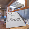"Tony's Famous Grill server Renee Chesterfield holds up a sign saying ""Open for Dine-In"" Monday morning at Tony's Famous Grill in Goshen."