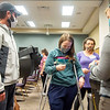 """Casey Wilson, left, and his finance Jenna Perrin, both of Goshen, receive an """"I Voted"""" sticker Tuesday afternoon at Greencroft Community Center in Goshen."""