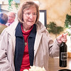 """Sue Griffen, of Elkhart, brings a bottle of wine with """"Trump"""" spelled out on the label Tuesday evening during the Republican Party After Election Party at Antonio's Italian Restaurant in Elkhart. The Democratic Party did not have an election watch party due to the rising numbers of COVID-19 cases in Elkhart County."""