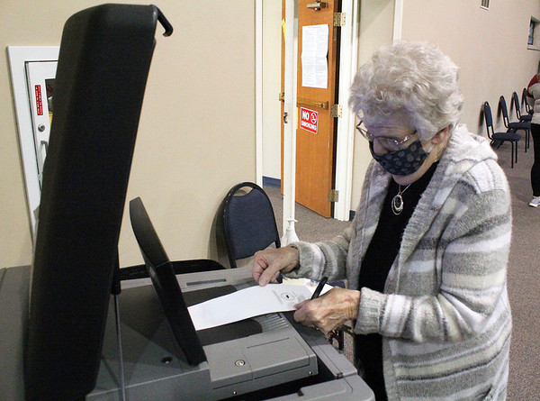 Roger Schneider | The Goshen News<br /> Sally Coffman slips her completed ballot into the ballot box Tuesday moring at the Elkhart County vote center at the Greene Road Church in Goshen.