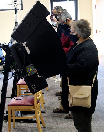 Roger Schneider | The Goshen News<br /> Voters cast their ballots Tuesday morning at the Green Road Church vote center in Goshen.