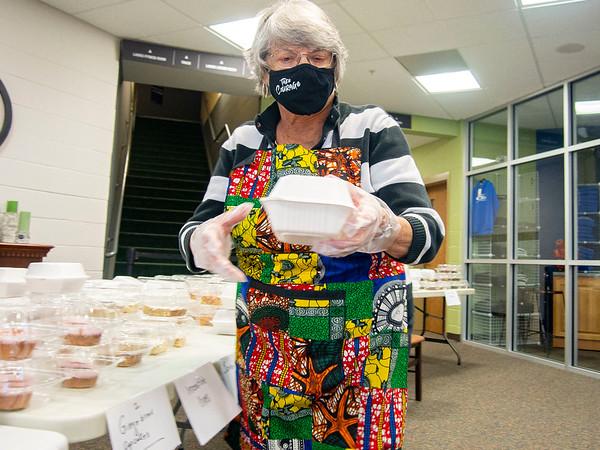 Ruby Wertz, of Goshen, grabs a dessert  for a customer during Saturdays The Window Haystack Fundraiser at Grace Community Church in Goshen.