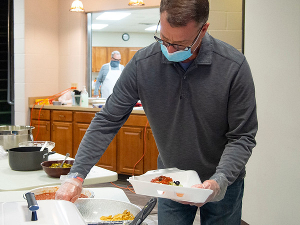 Mike Moore, of Syracuse, prepares a meal for a customer during Saturdays The Window Haystack Fundraiser at Grace Community Church in Goshen.