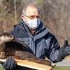 Elkhart County Parks Department naturalist Andy Langdon, left, holds up a North American River Otter in the parking lot of the Baintertown Dam in Goshen.
