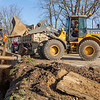 Selge Construction Co. Inc. forman Shawn Herman, left, directs heavy equipment operator Andrew Breslin where to dump stone Wednesday morning at near the intersection of East Lincoln Avenue and Steury Avenue in Goshen. This is site is part of the East Goshen water main replacement project.