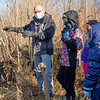 Elkhart County Parks Department naturalist Andy Langdon, left, shows a beaver pond to participants Monday during a Trail Trekkers: River Otters event near the Baintertown Dam in Goshen.