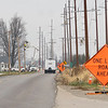 Northern Indiana Public Service Company crews work on putting in new power lines in Saturday at the intersection of County Road 38 and County Road 31 in Goshen.