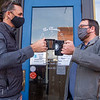 Goshen Mayor Jeremy Stutsman, left and local business owner Alex Dugger make a toast Thursday afternoon outside the Electric Brew in Goshen.