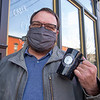 Local business owner Alex Dugger  holds a coffee cup outside the Electric Brew Thursday afternoon in Goshen.