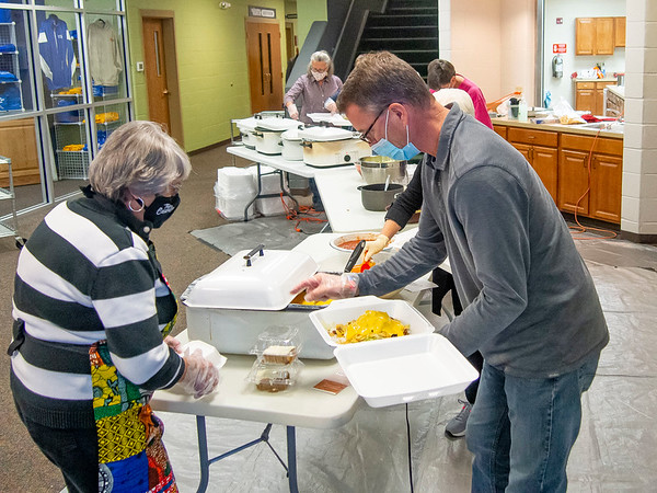 Mike Moore, of Syracuse, and Ruby Wertz, of Goshen, prepare a meal for a customer during Saturdays The Window Haystack Fundraiser at Grace Community Church in Goshen.