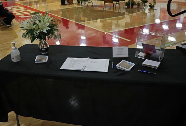 People attending the John Dechant ceremony of life were allowed to leave donations to the Goshen Wrestling Club or the Goshen Boys and Girls Club.