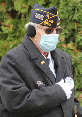 Roger Schneider | The Goshen News<br /> American Legion commander Terry Morgan holds his hand over his heart during Veterans Day services in Goshen Wednesday.