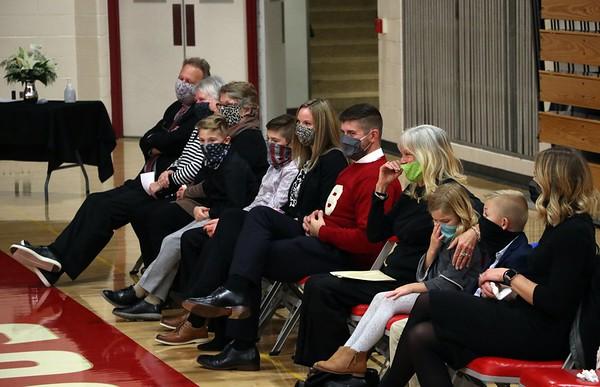 John Dechant's family looks on during John's son's, Shawn, speech Wednesday.