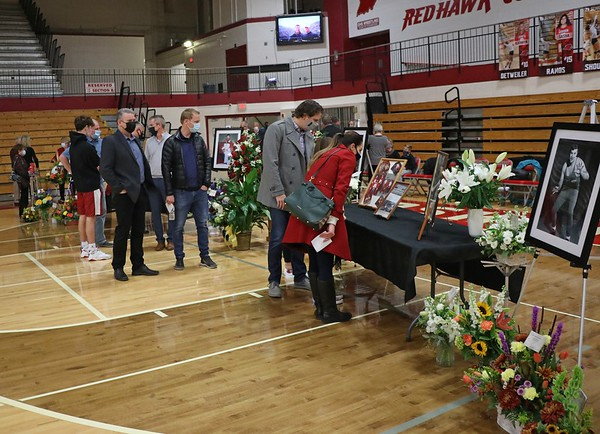 Many of the guests look at the pictures of John Dechant before the celebration of life service began for John Wednesday.