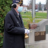 Roger Schneider | The Goshen News<br /> Commander of the Goshen American Legion, Terry Morgan, prepares to ring a bell that was tolled each time one of the names of the 12 veterans killed in the Global War on Terrorism is read. A plaque honoring those veterans was recently placed on the Elkhart County War Memorial.