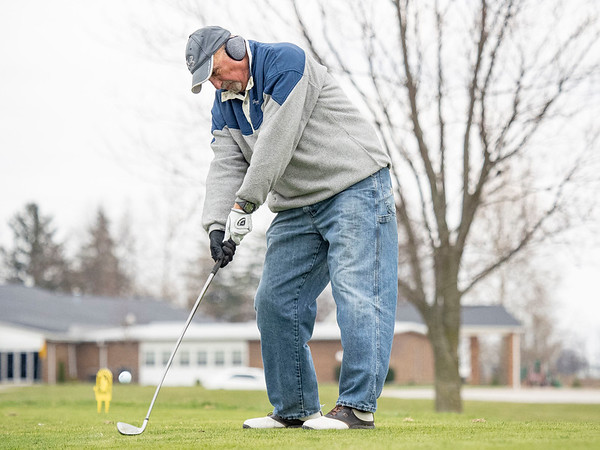 Tom Moon, of Osceola, chips a ball towards the green at McCormick Creek Golf Course in Nappanee. Temperatures for this weekend are expected to be in the low 50's, but expected to drop to the low 40's on Tuesday.