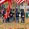 Roger Schneider | The Goshen News<br /> The Goshen Police Department honor guard members stand on the lawn of the Elkhart County Courthouse Wednesday during the annual Veterans Day ceremony.