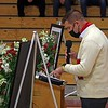 Shawn Dechant, son of John Dechant, reads an old poem of John's during his celebration of life Wednesday.