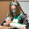 Hannah Hughes, 11, of Leesburg, paints her book green during Saturday's Magical Me Day at West Park and Pavilion in Nappanee.