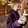 Robbie Yoder, 9, of Nappanee, receives a cinnamon roll Wednesday afternoon at Bonneyville Mill in Bristol. The cinnamon roll was made from flour that was produced at the mill.