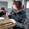 Hannah Stahley, of Nappanee, paints dark magic on her book during Saturday's Magical Me Day at West Park and Pavilion in Nappanee.