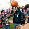 Nataly Esqueda, 16, left, along with her teammates Adrian Mora, 16, and Anthony Miller, 16, react after Goshen High School Engineering and Technology Teacher Jen Yoder, not pictured gives the thumbs up after their pumpkin survived after being dropped from 85 feet in the air Thursday morning at Goshen High School.  This is the 12th annual event for GHS Engineering classes doing their annual Pumpkin Drop. The Goshen Fire Department assisted in the experiment by providing the ladder truck to obtain the hight required for the experiment. The students used a balloons and pieces of other boxes inside the box used a vessel to protect their pumpkin from the impact.
