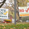 Vote yes and no signs on display Thursday morning at the intersection of North Huntington Street and Indiana State Road 13 in Syracuse.