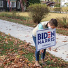 Nicole Craig adjusts a Joe Biden campaign sign in her yard in Goshen. The sign was a replacement for one that was stolen recently.