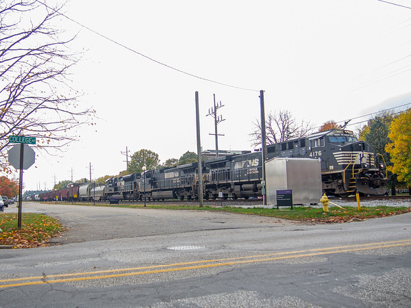A Norfolk Southern freight train approaches the College Avenue railroad crossing Tuesday in Goshen. Goshen College plans to remove the Ninth Street entrance and replace it with a new entrance at the intersection of South 10th Street and College Avenue.