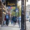 A man walks along the sidewalk near The Berkshire Room on East Ohio Street Sunday in Chicago, Illinois.