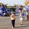 John Kline | The Goshen News<br /> Members of the Elkhart County Republican Party wave flags, hold up signs and cheer at passing vehicles while lining Lincoln Avenue during a Freedom and Trump Rally in front of the Elkhart County Courthouse late Saturday morning.