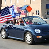 John Kline | The Goshen News<br /> A car full of Trump supporters drives north on Third Street past the Elkhart County Courthouse during a Freedom and Trump Rally held at the courthouse late Saturday morning in downtown Goshen.