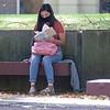Kaylee Herrera, of Ligonier, reads a book Wednesday morning on the Goshen College Campus.
