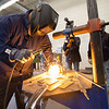Welding instructor Cole Keller demonstrates welding techniques to his class Monday morning at Ivy Tech Community College in South Bend. The class is one of several being offered for free by Ivy Tech through the state's Next Level Jobs initiative, which has seen a surge in interest in the months following COVID-19's arrival in the state.
