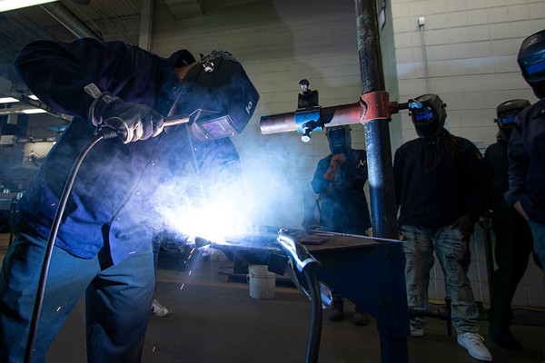 Shielded Metal Arc One Instructor Cole Keller demonstrates welding techniques to his class Monday morning at Ivy Tech Community College in South Bend. The class is one of several being offered for free by Ivy Tech through the state's Next Level Jobs initiative, which has seen a surge in interest in the months following COVID-19's arrival in the state.