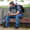 Benji Wall, of Goshen, sits on a bench  between classes Wednesday morning nearthe  Harold & Wilma Good Library on the Goshen College campus.