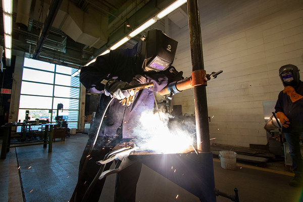 Welding nstructor Cole Keller demonstrates welding techniques to his class Monday morning at Ivy Tech Community College in South Bend. The class is one of several being offered for free by Ivy Tech through the state's Next Level Jobs initiative, which has seen a surge in interest in the months following COVID-19's arrival in the state.