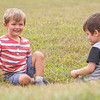 """James Miller, 3, plays near a storm drain with Elam Stoltzfus, 3, Tuesday morning along the track at Goshen College Eigsti Track and Field Complex. The kids pictured were saying """"What's your name?"""" down  into the drain."""