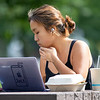 Priscilla Taniyaya, of Indonisa, studies at a picnic table on the campus of Goshen College Wednesday morning.